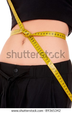 Fitness woman with measure tape on white background