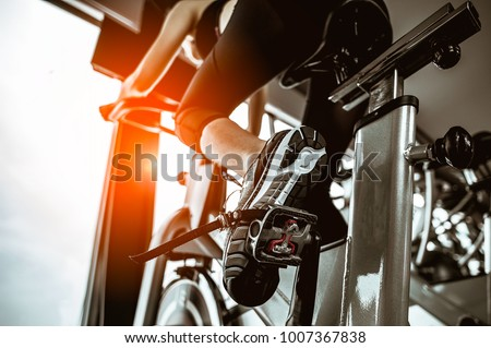 Fitness woman working out on exercise bike at the gym.exercising concept.fitness and healthy lifestyle  #1007367838