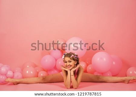 38dda0af89e fitness workout of little girl in pink studio. fitness workout of small girl  kid in