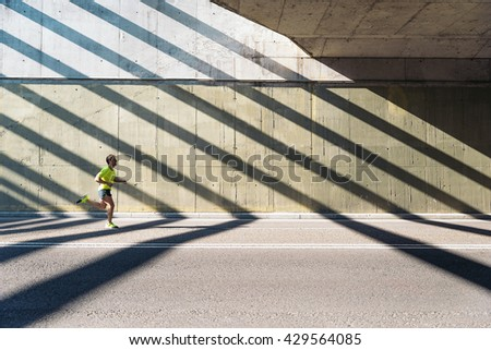 Fitness, workout, sport, lifestyle concept. Man running in the city.