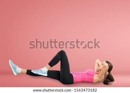 Fitness Workout. Young Woman Doing Bicycle Crunch Abs Exercise Over Pink Studio Background. Panorama