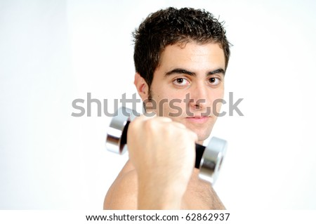 Fitness - Young man lifting weights
