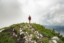 Fitt hiking girl on top of the mountain