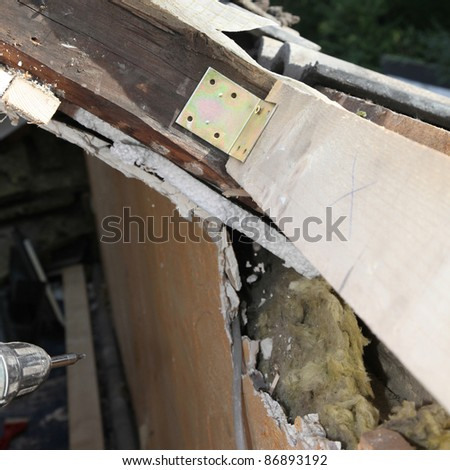 Fitting roof windows - close up of wooden construction