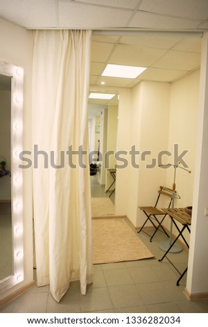 Fitting room in the store, in the showroom.Light curtain, lots of light.
