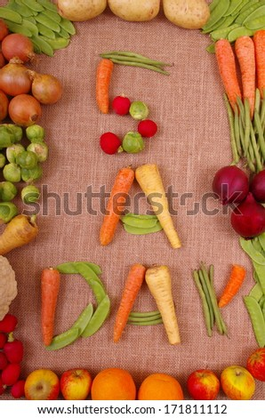 Five A Day Fruit and Vegetables Fresh vegetables and fruit laid out to show the healthy eating message of 5 a day