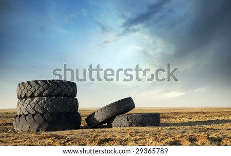Five abandoned tires outdoors as a symbol of environmental pollution