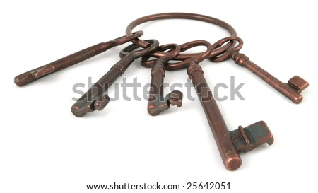 Five ancient keys on a white background