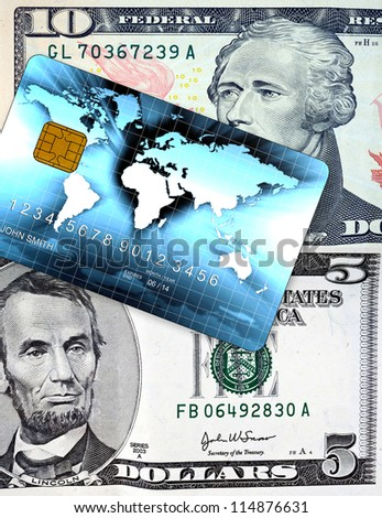 five and ten us dollar bill detail closeup with credit card