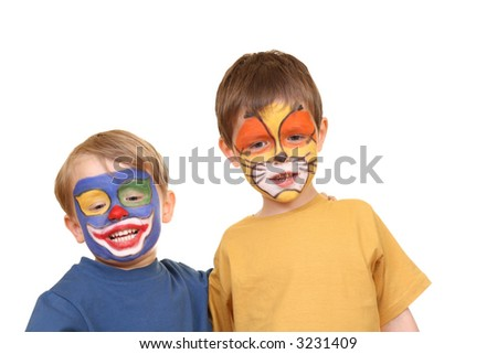five and three years old boys with painted faces isolated on white