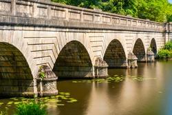 Five-arch bridge over Virginia Water lake in Surrey, UK. Long exposure effect