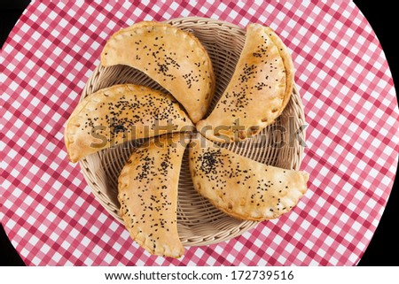 Five bakery in basket on table upper view