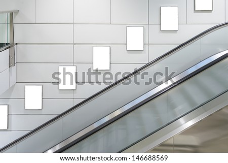 Five big vertical / portrait orientation blank billboard with escalator background