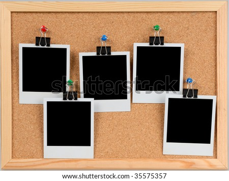 five blank cards on the cork board - stock photo
