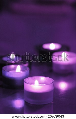 five burning candles on the table (purple)