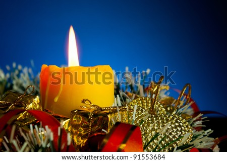 Five burning colorful candles against blue background