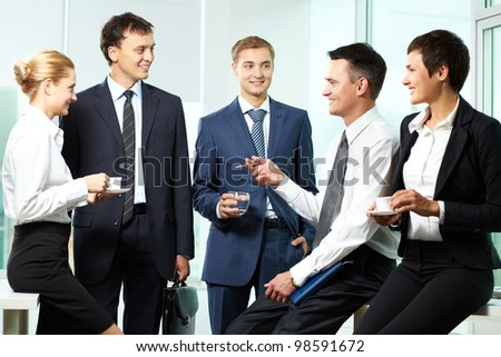 Five business colleagues communicating at break