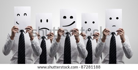 Five business men holding a card with emotional face. On a gray background