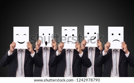 five businessman holding a card with drawing facial expressions different emotion feelings face on white paper Foto d'archivio ©