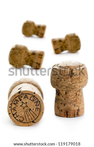 five champagne corks isolated on a white background