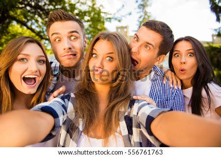 five cheerful fooling best friends making selfie photo and having fun