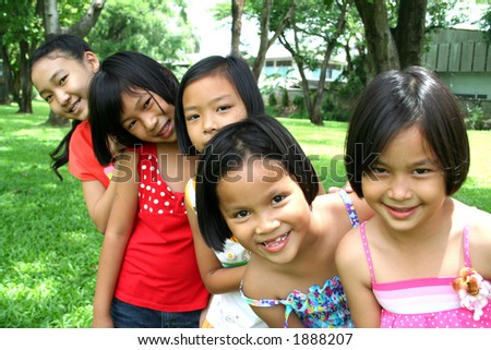 Five children having good time in the park.