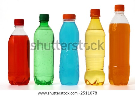 five colored bottles with juice