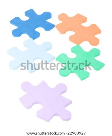 five colored puzzle blocks