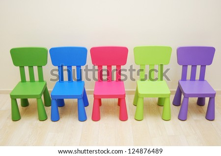 Five colorful chairs in Montessori Kindergarten Preschool Classroom