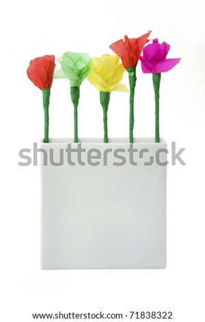 five colorful paper flowers made by child in white vase