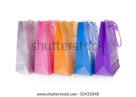 Five colorful shopping bags isolated on white