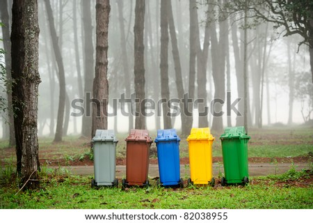 five colors recycle bins in pine forest