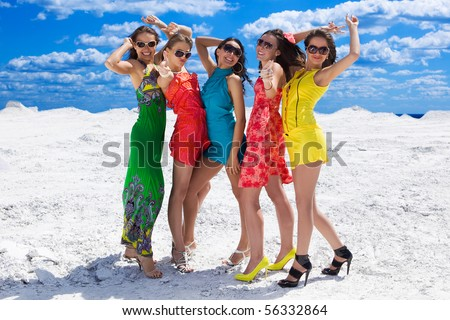 Five Cute sexy girls on the snow ready for party - stock photo