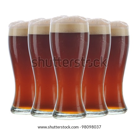 Five dark frosty beer glasses arranged over a white background.