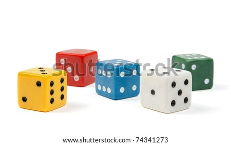 Five dices of different colors on white background.