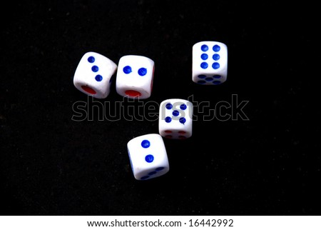 Five Dices on the black background.
