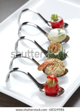 five different appetizers served in a modern style