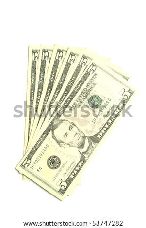 Five dollar bills on white background