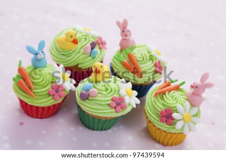 Five easter themed cupcakes with bunnies, chicks, eggs, carrots and flowers
