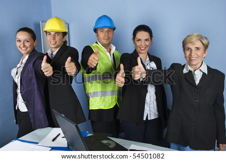 Five engineers team give thumbs up and smiling in a office showing successful in business