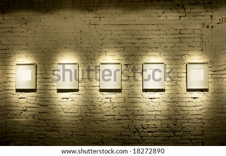 Five frames on brick wall