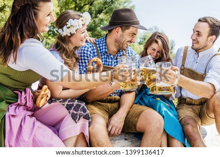 Five friends having fun on Bavarian RIver and clinking glasses with Oktoberfest  Photo stock ©