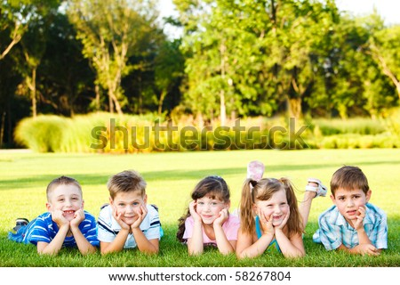 Five friends lying on grass