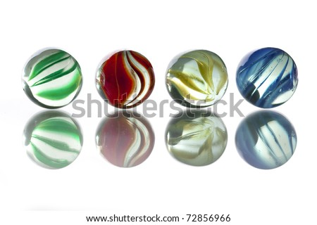 five glass marbles: green, red, yellow, blue on white background