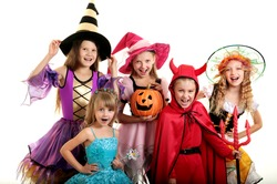 Five Happy Children in Halloween Costumes of Witches, Demon and Princess.