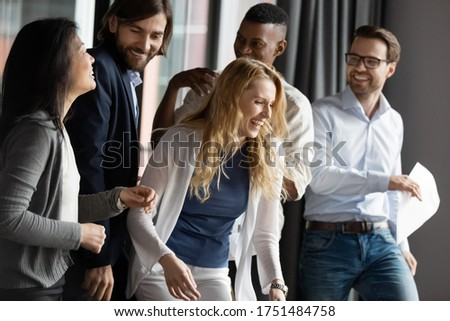 Five happy diverse colleagues staff members department enjoy common success, celebrating reward promotion, laughing having fun at workplace, great news sales results, closing successful deal concept ストックフォト ©