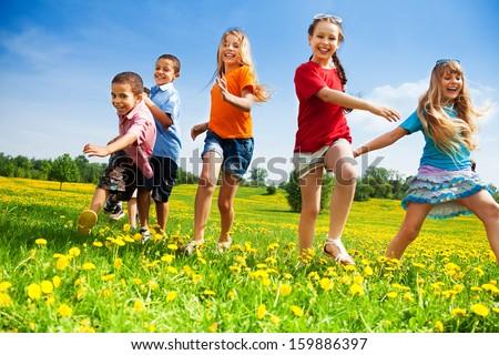 Five happy diversity looking children running in the park #159886397
