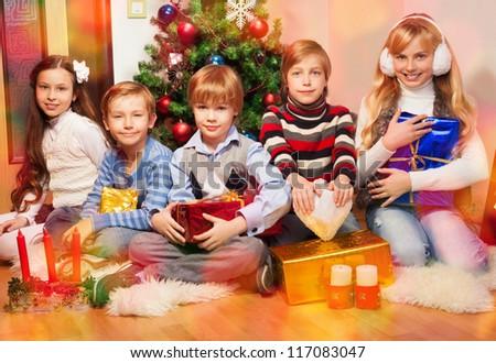 Five happy kids celebrating Christmas