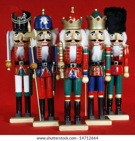 five holiday nutcrackers with red background - Shutterstock ID 14712664