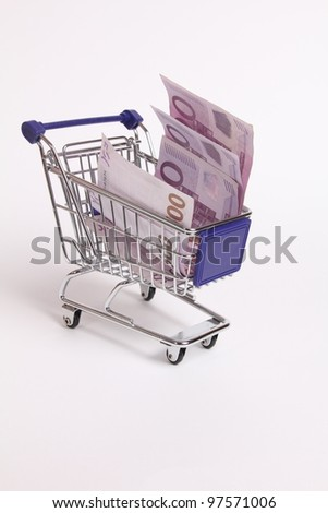 Five hundred euro banknotes in a shopping cart isolated